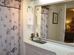 Leith Court #12 has a nice, clean master bathroom en-suite with large vanity, toilet & shower stall.