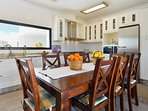 Fully equipped modern kitchen with dining area
