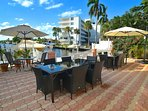 Private Rear Waterfront Lounge Features Three (3) Dining Tables + Sofa Lounge...