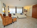 Villa Two Open Living Area Features Leather Sectional Sofa, Reading Chair + LED Television...