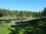While golfing the Bear, enjoy this view of the 18th hole, maybe before relaxing on the deck