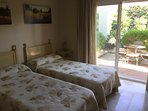 Twin bedroom with ensuite and sun terrace