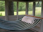 Relax in one of the hammocks in the bungalow by the pond