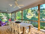 Outdoor dining on screened deck seats 8