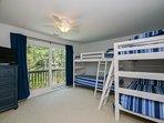 Boys bedroom. 2 bunks, 4 single beds.  Dresser and closet.