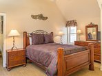 Master Bedroom #1 is comfortable and spacious with a king bed and a flatscreen TV.