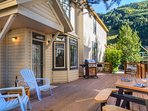 The outdoor patio is large and has plenty of seating for the family.