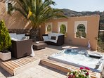 Chill out in the Jacuzzi or comfy seating under the shade of a palm tree, with stunning views.