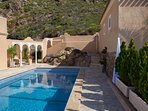 View from the pool towards the Villa's distinctive arches.