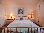 The upstairs bedroom has a queen size bed, walk out balcony, and bathroom.