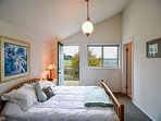 The balcony overlooks one of the beautiful farm fields of Lopez Island. You can see the entrance to the bathroom on the...
