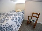 A photo of the second single bed directly across from the first.