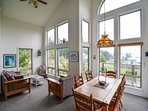 The large windows let in beautiful light making this room of the home bright and cheerful.