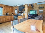 Handcrafted log table in fully stocked kitchen