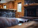 breakfast bar and wood burning fireplace