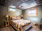 lower level bedroom with real barn roof steel ceiling!