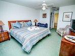 Master bedroom 1 King size Bed 2 walk in closets Door En-Suite  32' TV  Patio doors to pool side.