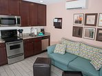 Cherry cabinets, ss appliances including dishwasher, granite counter, grohe fixtures