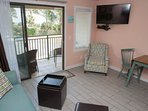 Living area with ocean view plus 42 inch flat screen TV and DVD player