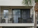 Balcony with lots of comfortable seating and ocean view!