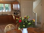 Fresh flowers in the sunny dining kitchen room.