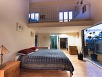 Master bedroom with loft space with two twin beds