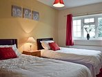 TWIN ROOM OVERLOOKING THE GARDEN AND TOWARDS THE COTSWOLD HILLS