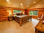 Master bedroom boasting a King-size 150-year-old reclaimed Wyoming Barnwood bed.