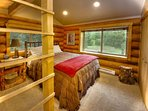 Lumberjack room featuring a queen-size hickory log pole bed and loft bed.