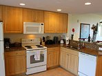 Fully Stocked Kitchen - Granite Counters LED lights plus tasteful accessories.