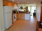 View at Entry of Kitchen, General Layout, Tile/Granite Counters and Amenities.