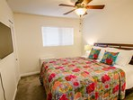 Bedroom 1: Queen Bed, Wall Mounted TV with Netflix, Ceiling Fan, Side tables with Lamps, closet, carpeted