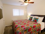 Master bedroom has queen bed, ceiling fan, bedside tables, closet and TV with Netflix