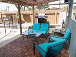 Covered patio with BBQ is a great place to relax in the shade & eat while you watch the kids swim!