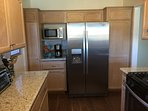 Kitchen with all new stainless appliances and granite counters