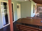 Entrance to Bottlebrush Cottage with wide verandah and BBQ and outdoor furniture.