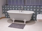 The ensuite with restored French Victorian roll top bath