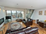 Beautiful living room with comfortable sofas, flat screen, smart tv, fireplace and terrific views