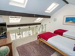 Very spacious, bright and airy mezzanine level with two full size single beds