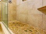 Large stone and tile walk in shower