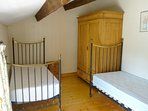 Bedroom 3 - Contains 2 single beds, wardrobe and a chest of drawers.