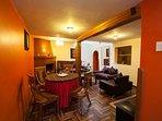 Sala Comedor en Primer piso con Chimenea y sofa cama.