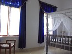 blue bedroom (1 double bed + 1 single bed) + air conditioned