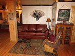 queen leather sleeper sofa, chair, nice sitting area.