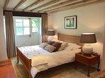 Double bedroom with doors onto the garden