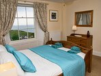Master bedroom with king size bed and wonderful sea view