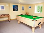 Games room with pool table, table football and dart board.