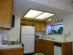 Kitchen with major appliances; well stocked too!
