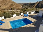 Aerial view of large terrace, private heated swimming pool panoramic views of Andalucian countryside