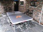 table tennis under car port + bar seats
